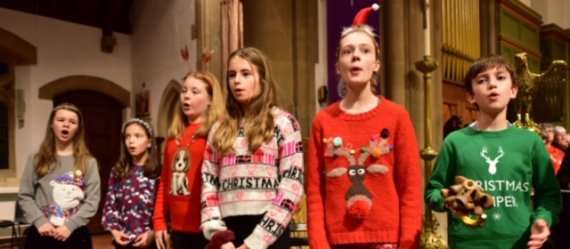 Members of Nightingales DASP Children's Choir sing at the Combined Choirs Christmas Concert