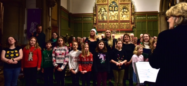 Kathie conducts the DCH Choir and Nightingales Children's Choir at the Christmas Concert 2019