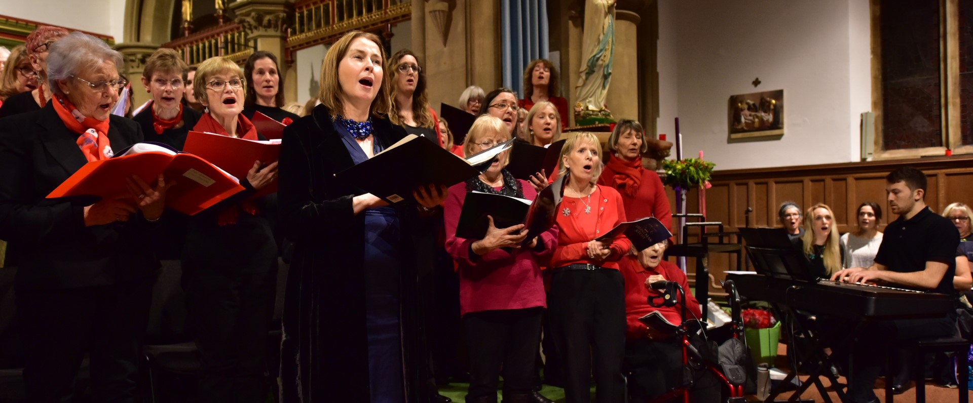 Niamh O'Hanlon, Jacob Stone and members of Viva! singing at the Combined Choirs Christmas Concert
